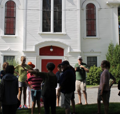 Curator Paige Lilly leads a walking tour on Main Street, Castine. Photo 2013.