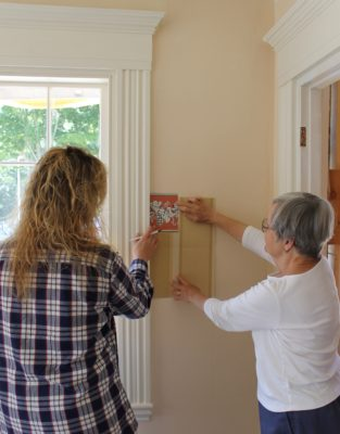 Wallpaper Contractor Cherie Cushman works with Castine Historical Society historic interiors consultant Gail Winkler in the Society's Grindle House.