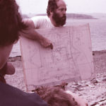 Alaric Faulkner explaining the diagram of Fort Pentagoet at the dig site, 1982