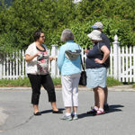 2016 Intern Sarah LaVenture leads a walking tour on the town common.