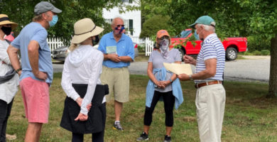 Volunteer Mike Coughlin leads a walking tour