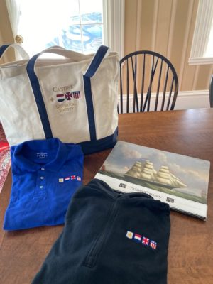 A fun sampling of items in our gift shop including a CHS boat bag, Pickering placemats of the ship Castine, House and Garden Tour tea towel, four flags logo polo shirt (sizes are limited), and a four flags black fleece (choose your size). Winner picks their size of clothing at a later date. Donated by the Castine Historical Society.