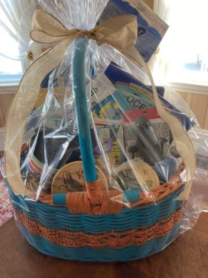 A perfect gift for that special child who loves the seashore, this basket is filled with kids books and toys. Plus a few goodies for you! Donated by Karen Burnett Kurie
