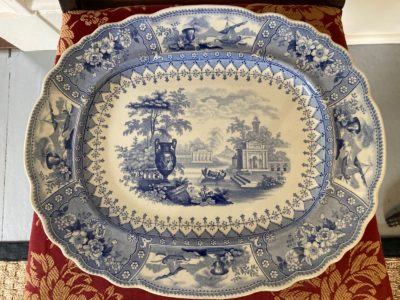 This beautiful antique platter features an urn and gondola type boat in a classical landscape. The oval platter with a scallop rim was made by Thomas Mayer, Longport, England in the second half of the 19th century. Excellent condition. Provenance: from the Collection of James Dunn, Springfield, Vermont. Donated by Jordan Richards, Antiques at the Inn