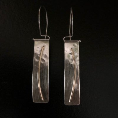 """These beautiful earrings are made from hammered sterling with 14K gold wire hanging from hand-fabricated sterling tube and wire swing arms. Earring dimensions are 2 ¼"""" long x 1 ½"""" wide. Designed and donated by Lisa Friedman, https://lsfdesignandfabrication.com/"""