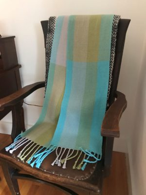 This 8 foot long x 10 inch wide wrap is perfect for Castine evenings. It is hand woven using pearl cotton in a twill pattern by Peggy O'Neil Murphy. Donated by Peggy O'Neil Murphy.